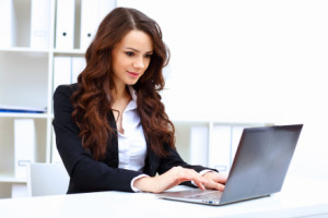 Stock photos of a woman with and laptop